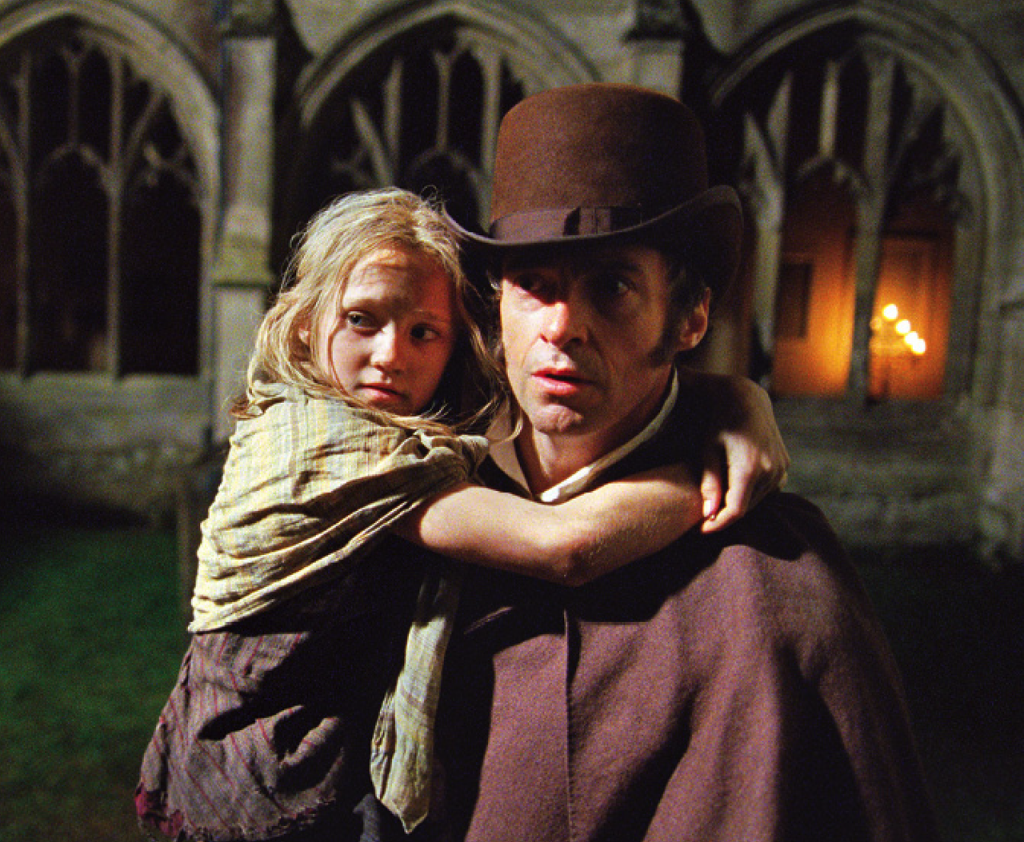 Isabelle Allen as young Cosette and Hugh Jackman as Jean Valjean.