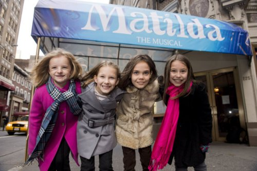 Milly Shapiro, Sophia Gennusa, Oona Laurence, and Bailey Ryon in front of the marquee for their Broadway debut.