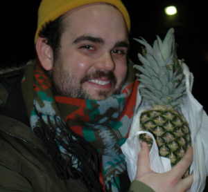Greg Hildreth holding a pineapple. Any PATSC fan knows why.