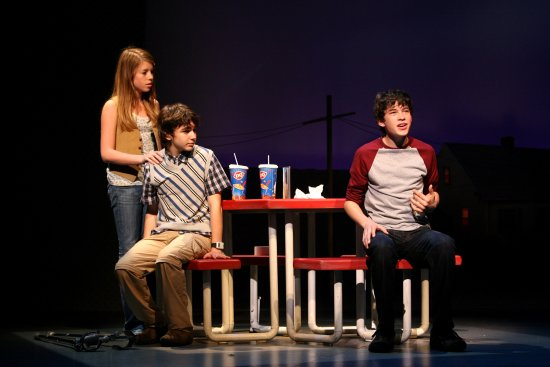 Graham Phillips, right, Allie Trimm, left, and Aaron Simon Gross during a performance of 13.
