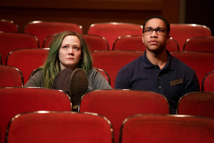Louisa Krause and Aaron Clifton Moten watch a movie