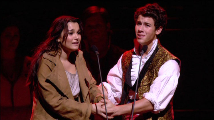 Samantha Barks as Eponine and Nick Jonas as Marius in the 25th anniversary