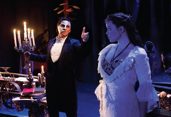 "Earl Carpenter as the Phantom and Katie Hall as Christine in the UK Tour of ""The Phantom of the Opera."""