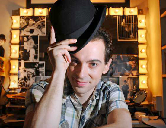 Rob McClure shows off his Charlie Chaplin bowler hat